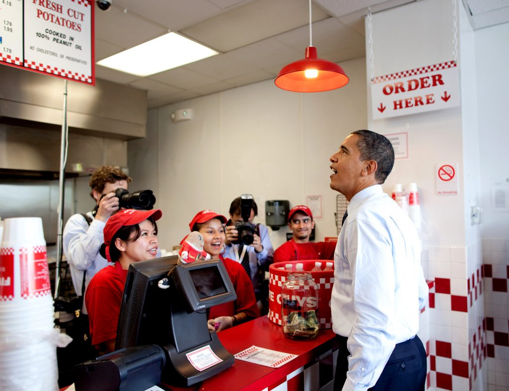 President Obama orders lunch at Five Guys in Washington, D.C. during an unannounced lunch outing May 29, 2009. (Official White House Photo by Pete Souza)This official White House photograph is being made available for publication by news organizations and/or for personal use printing by the subject(s) of the photograph. The photograph may not be manipulated in any way or used in materials, advertisements, products, or promotions that in any way suggest approval or endorsement of the President, the First Family, or the White House.