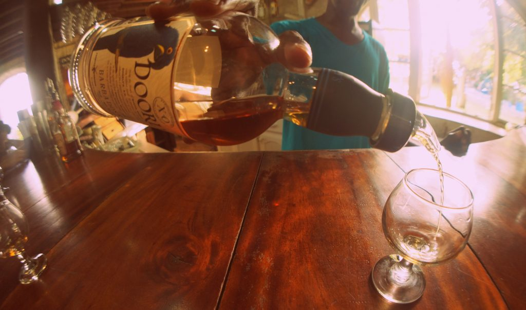 Pouring Doorly's XO Rum at the Foursquare Rum Distillery in Barbados