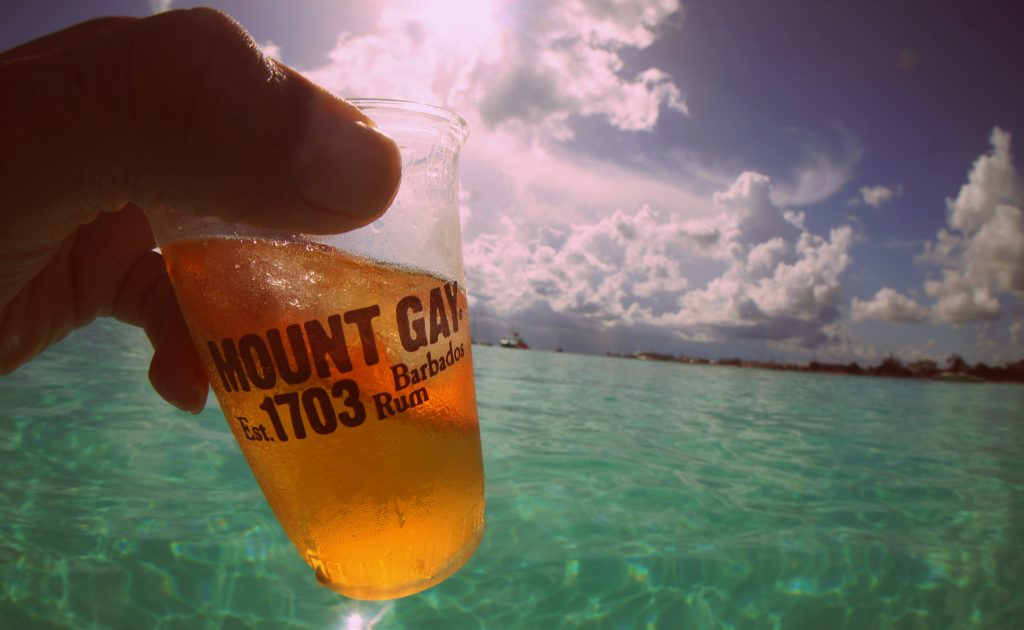 Drinking rum on a beach in Barbados